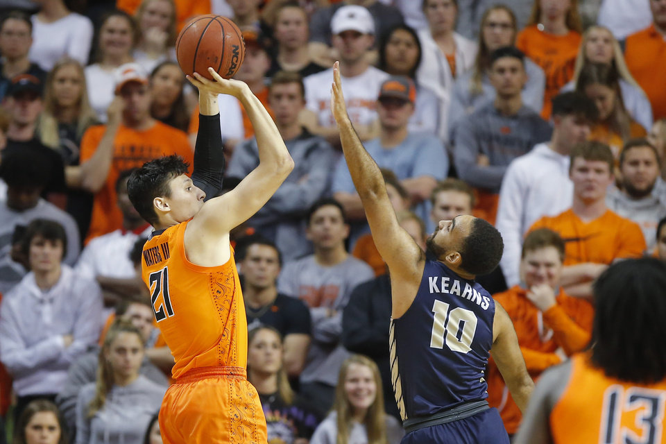 Photo - Oklahoma State's Lindy Waters III (21) shoots a basket over Sam Kearns (10) of Oral Roberts during an NCAA basketball game between the Oklahoma State University Cowboys (OSU) and the Oral Roberts Golden Eagles (ORU) at Gallagher-Iba Arena in Stillwater, Okla., Wednesday, Nov. 6, 2019. Oklahoma State won 80-75. [Bryan Terry/The Oklahoman]