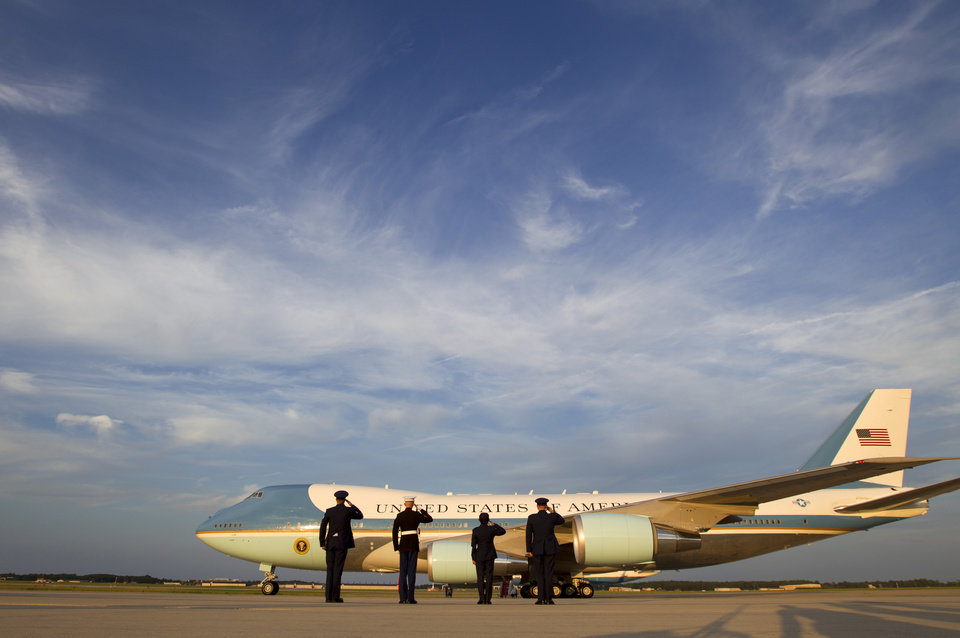 Photo - Military personnel salute Air Force One, with President Barack Obama aboard before departing at Andrews Air Force Base, Md. on Monday, June 2, 2014. Obama begins his three-country trip to Poland, Belgium and France on Monday.  (AP Photo/Jose Luis Magana)