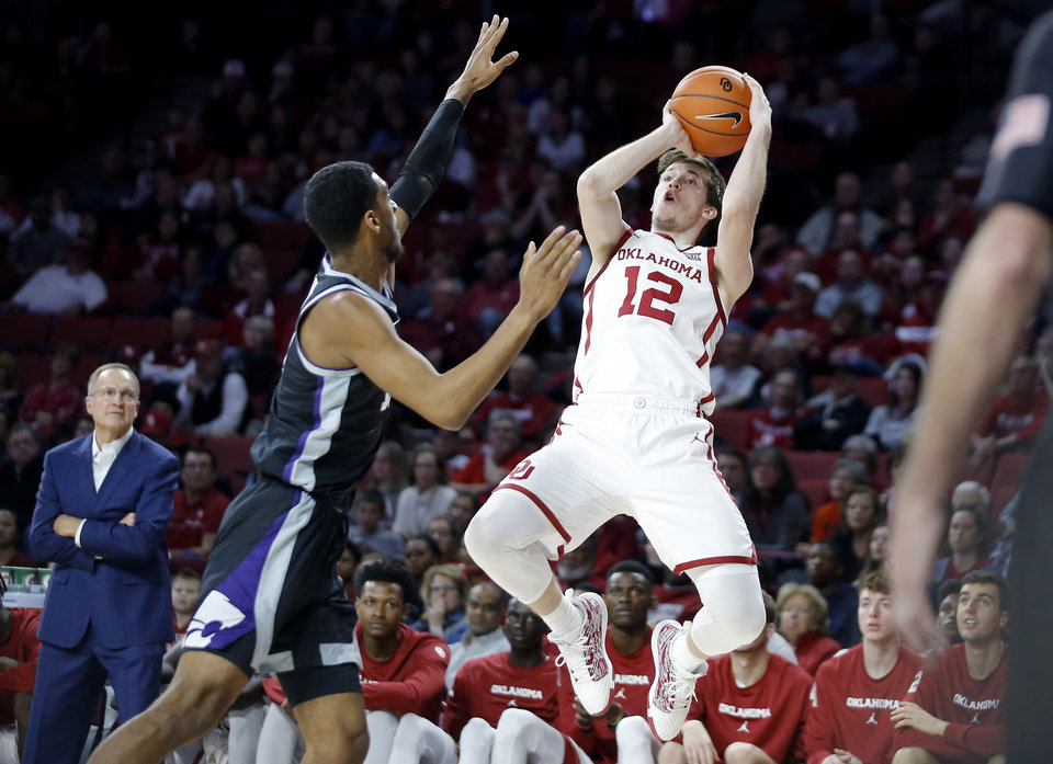 Photo - Oklahoma's Austin Reaves (12) puts up a shot beside Kansas State's Antonio Gordon (11) during an NCAA college basketball game between the University of Oklahoma Sooners (OU) and the Kansas State Wildcats at Lloyd Noble Center in Norman, Okla., Saturday, Jan. 4, 2020. Oklahoma won 66-61. [Bryan Terry/The Oklahoman]