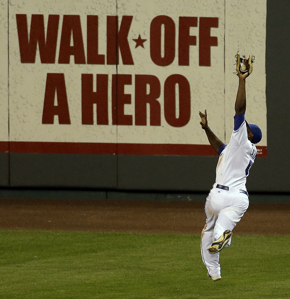 Photo -   Kansas City Royals center fielder Lorenzo Cain catches a fly ball hit by Texas Rangers' Nelson Cruz to end the eighth inning of a baseball game, Thursday, Sept. 6, 2012, in Kansas City, Mo. (AP Photo/Charlie Riedel)