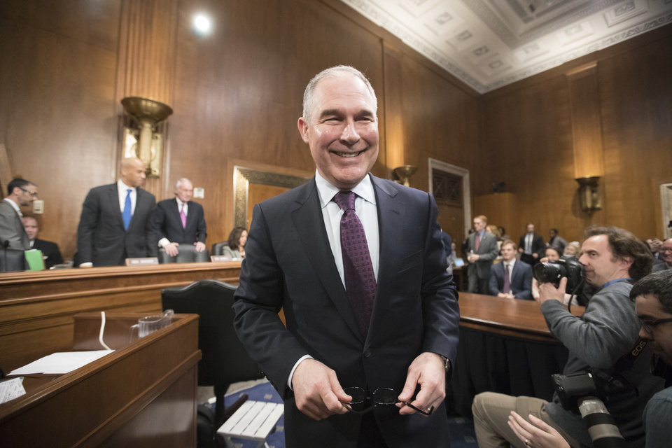 Photo - Environmental Protection Agency Administrator-designate Scott Pruitt arrives on Capitol Hill in Washington, Wednesday, Jan. 18, 2017, to testify at his confirmation hearing before the Senate Environment and Public Works Committee. (AP Photo/J. Scott Applewhite)