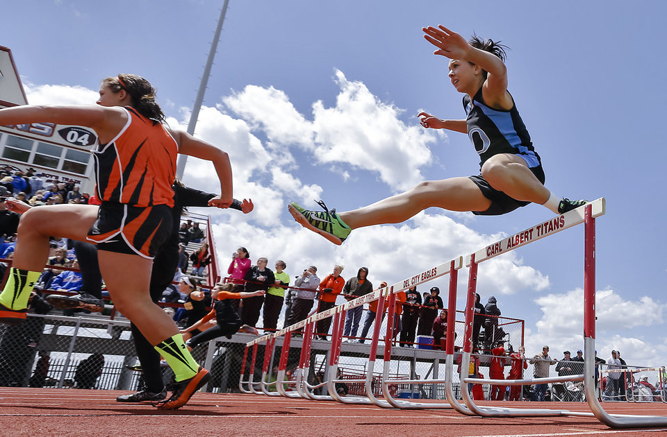 Okeene's Bethany Meier clears the hurdle  in the Class A 100m hurdles during the Class A and 2A state championship track meet at Carl Albert High School on Friday, May 3, 2013, in Midwest City, Okla. Photo by Chris Landsberger, The Oklahoman