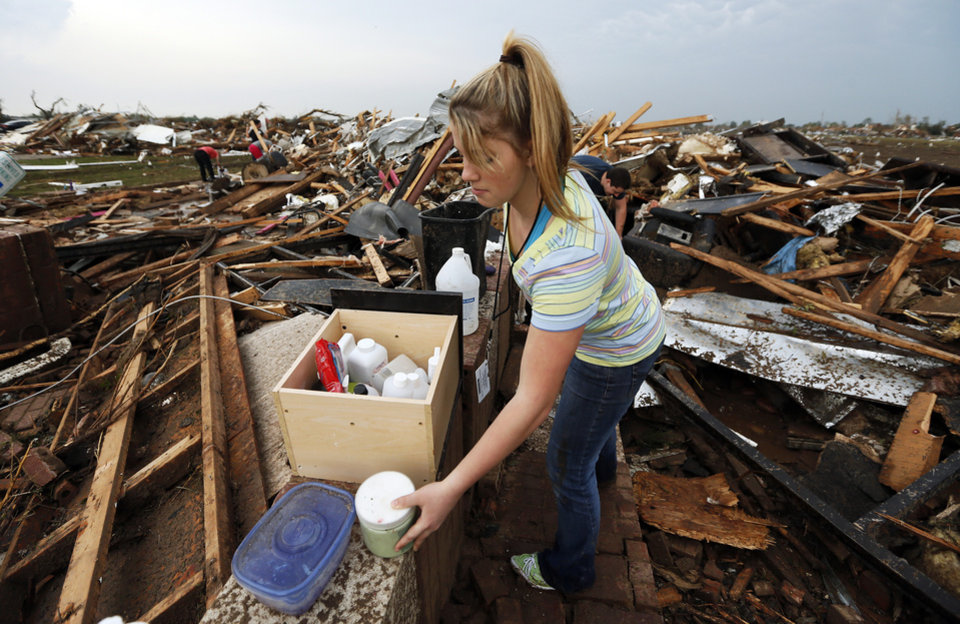 Lacey Tate collects items from the debris of her mother Sharese Tate's salon, Trenz, near SW 149th and Western after a tornado struck south Oklahoma City and Moore, Okla., Monday, May 20, 2013. Photo by Nate Billings, The Oklahoman