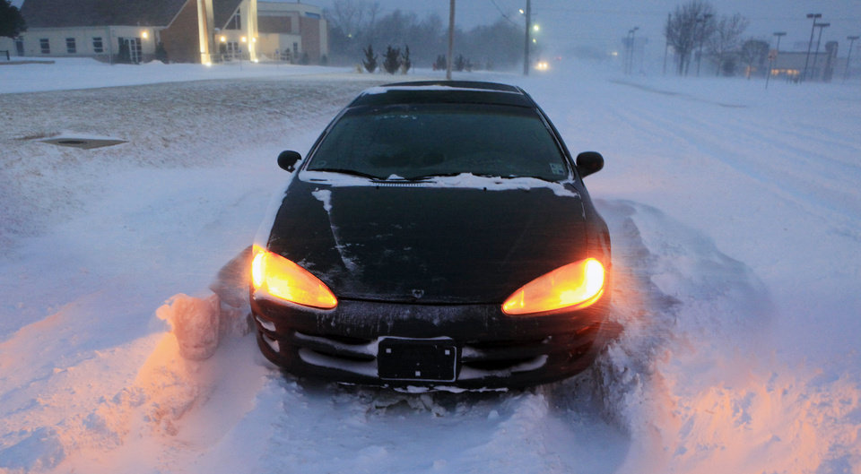 A car stuck in a snow drift on NW 63 Street between Tulsa Ave. and the NW Expressway in Oklahoma City Tuesday, Feb. 1, 2011.  Photo by Paul B. Southerland, The Oklahoman