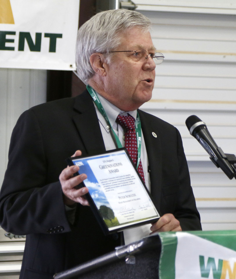 EPA Superfund Division Director Carl Edlund presents an official declaration Friday during a celebration of the deletion of the Superfund designation and the expanded gas-to-liquid facility at Waste Management's East Oak Landfill site in Oklahoma City. Photo by Paul Hellstern, The Oklahoman  <strong>PAUL HELLSTERN -  Oklahoman </strong>