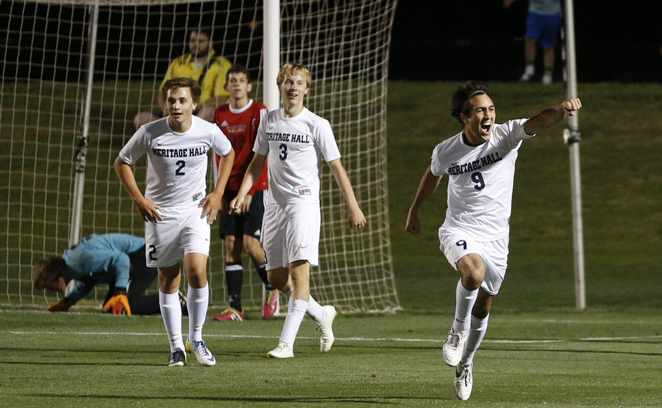 Photo - Heritage Hall's Zane Nassar celebrates after a goal as teammates Davis Angel, left, and Garrett McLaughlin watch during the Class 5A boys soccer championship between Heritage Hall and Skiatook in Norman, Okla., Friday, May 16, 2014. Photo by Bryan Terry, The Oklahoman
