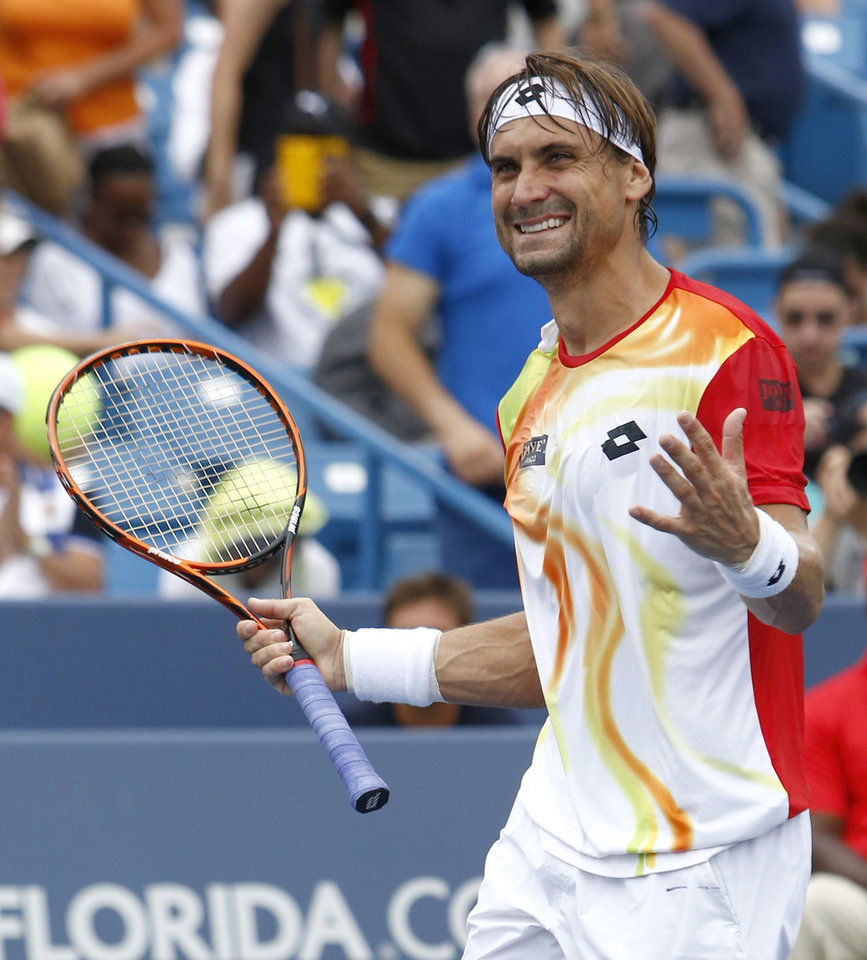 Photo - David Ferrer, from Spain, reacts after defeating Julien Benneteau, from France, in a semifinal match at the Western & Southern Open tennis tournament, Saturday, Aug. 16, 2014, in Mason, Ohio. (AP Photo/David Kohl)