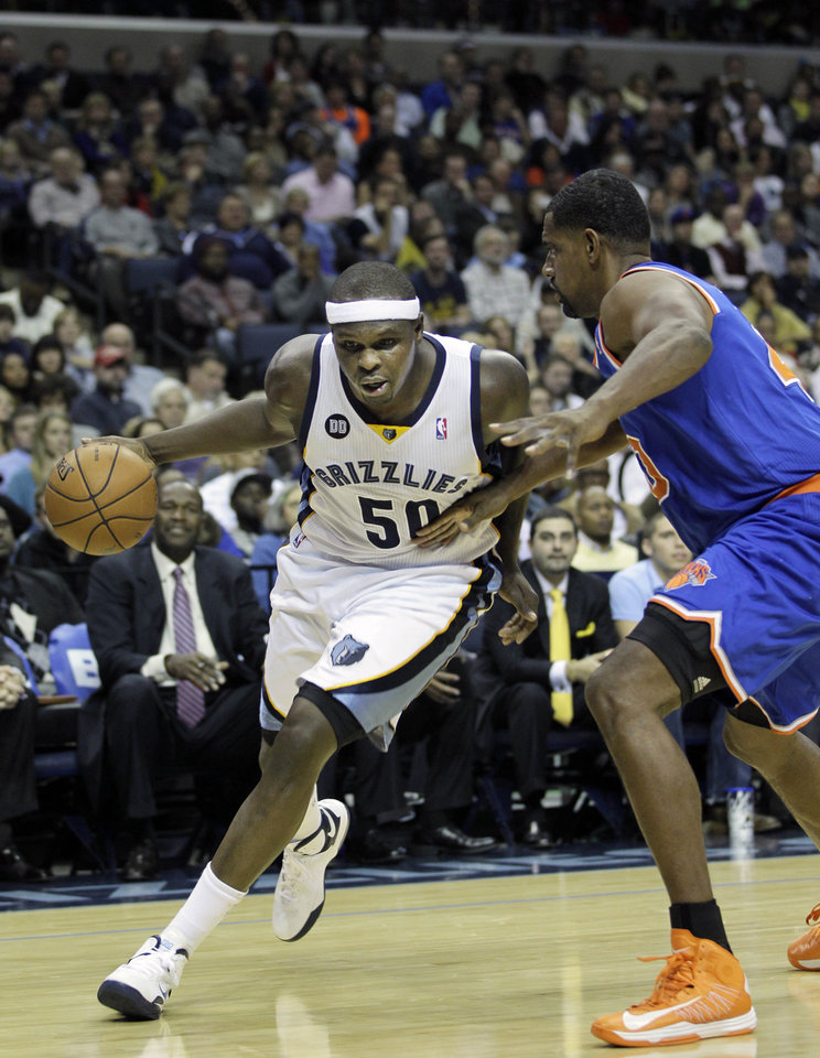 Memphis Grizzlies' Zach Randolph (50) moves around New York Knicks' Kurt Thomas during the second half of an NBA basketball game in Memphis, Tenn., Friday, Nov. 16, 2012. The Memphis Grizzlies defeated the New York Knicks 105-95. (AP Photo/Danny Johnston)