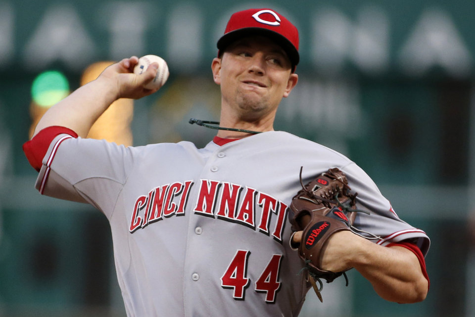Photo - Cincinnati Reds starting pitcher Mike Leake (44) delivers during the first inning of a baseball game against the Pittsburgh Pirates in Pittsburgh Monday, April 21, 2014. (AP Photo/Gene J. Puskar)