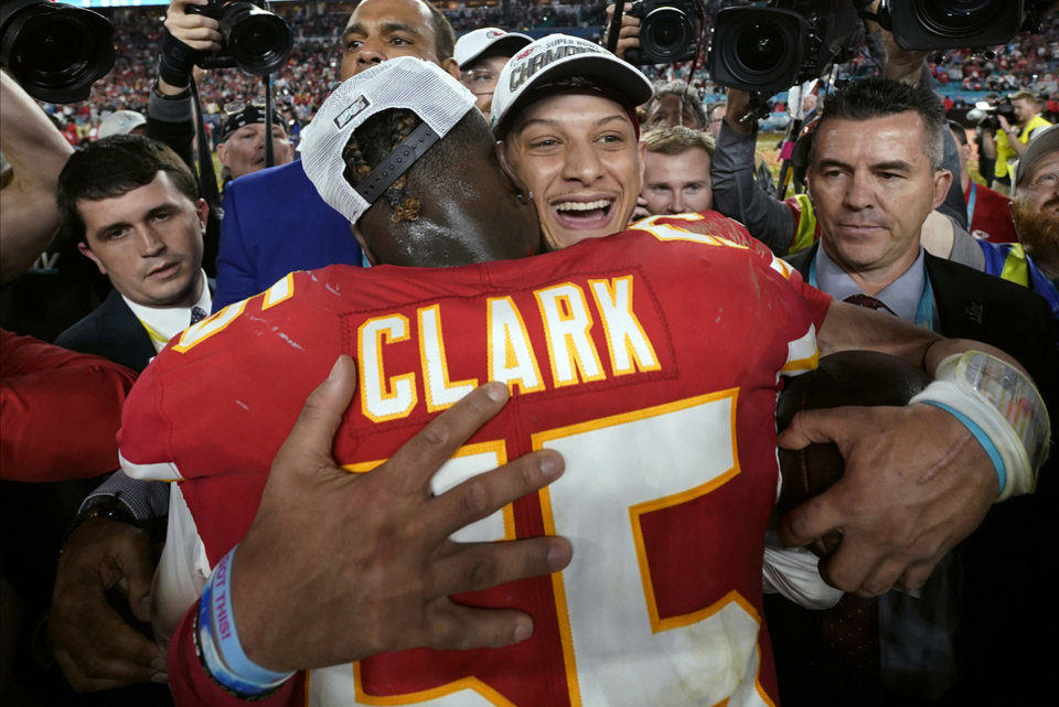 Photo - Kansas City Chiefs quarterback Patrick Mahomes, rear, celebrates with Frank Clark after defeating the San Francisco 49ers in the NFL Super Bowl 54 football game Sunday, Feb. 2, 2020, in Miami Gardens, Fla. (AP Photo/David J. Phillip)