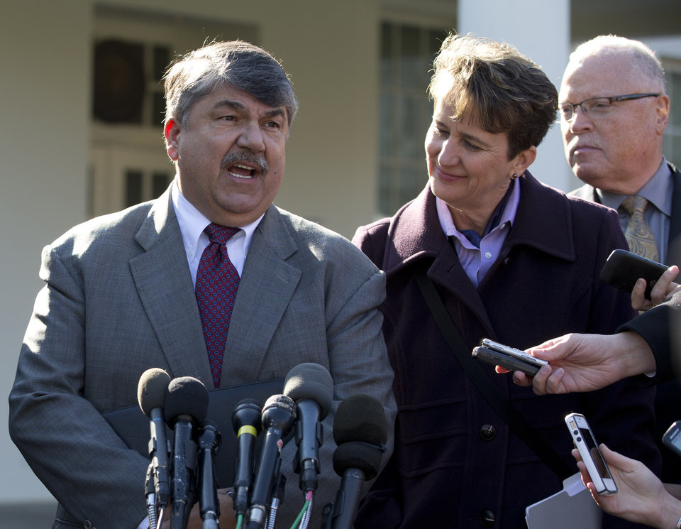 Photo -   AFL-CIO President Richard Trumka, left, accompanied by Mary Kay Henry, International President of the Service Employees International Union, center, and Lee Saunders, president of the American Federation of State, County and Municipal Employees, right, speaks to reporters outside the White House in Washington, Tuesday, Nov. 13, 2012, after a meeting between business leaders and President Barack Obama to discuss the economy and deficit. (AP Photo/Carolyn Kaster)