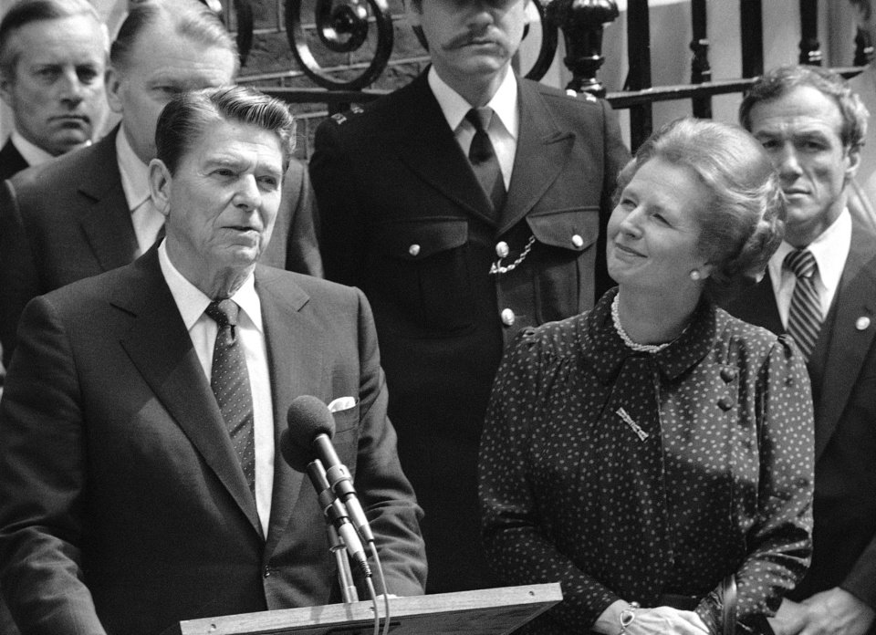 FILE - In this June 9, 1982 file photo, Britain\'s Prime Minister Margaret Thatcher, right, smiles with satisfaction as President Ronald Reagan makes a farewell speech outside her Downing Street office in London prior to his departure for Bonn. It is not often that the president of the United States needs to seek fashion advice. But when Ronald Reagan was getting ready for a visit to England as a guest of Queen Elizabeth II in June 1982, his people had an important question for the Brits: Just what does one wear to go riding with the queen in the magnificent horse country surrounding Windsor Castle? The answer: Something smart, but casual, of course. Riding boots, breeches and a turtleneck sweater would do fine _ no need for formal riding attire. The fashion inquiry is but one tidbit contained in nearly 500 pages of formerly Confidential documents relating to the Reagan visit being made public Friday, Dec. 28, 2012 by Britain's National Archives. (AP Photo/Bob Dear, File)