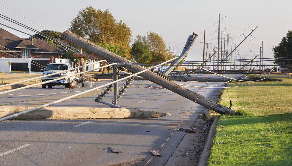 Power lines and poles down on Rockwell Boulevard near NW 131 Street in Oklahoma City Tuesday, Aug. 9, 2011. A thunderstorm moved through the area Monday evening causing storm damage. Photo by Paul B. Southerland, The Oklahoman