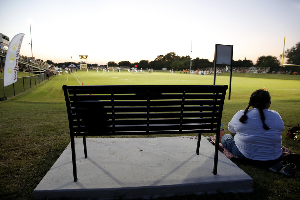 Photo - A bench dedicated to Jacie Cochran is seen during a high school football game between Cashion and Perry in Cashion, Okla., Friday, Sept. 4, 2020. Jacie died July 2 shortly after giving birth to Jaxon. [Bryan Terry/The Oklahoman]