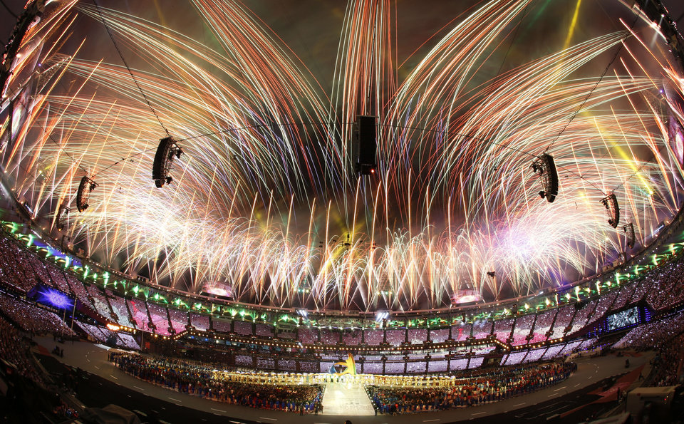 In this photo taken with a fisheye lens, pyrotechnics light up the sky above the Olympic Stadium during the Closing Ceremony at the 2012 Summer Olympics, Sunday, Aug. 12, 2012, in London. AP photo