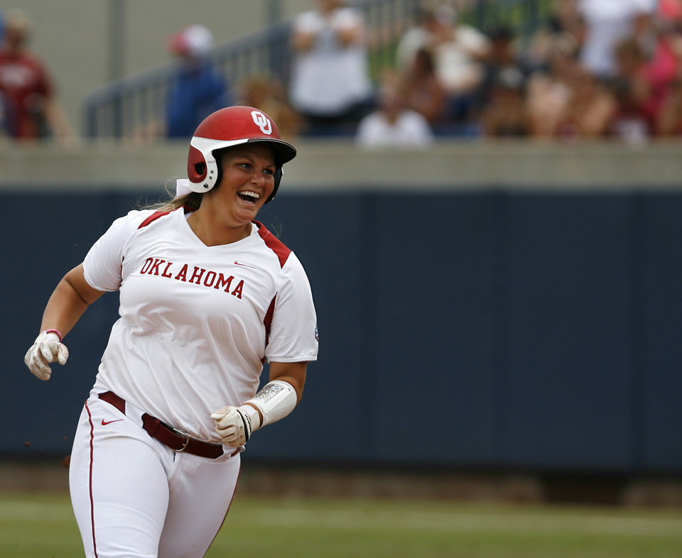 Oklahoma's Katie Norris (33) runs the bases after hitting a home run during a Women's College World Series game between Oklahoma University and Arizona State University at ASA Hall of Fame Stadium in Oklahoma City, Sunday, June 3, 2012.  Photo by Garett Fisbeck, The Oklahoman