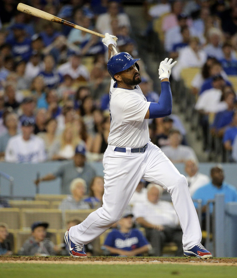 Photo - Los Angeles Dodgers' Matt Kemp hits a two-run home run during the second inning of a baseball game against the Atlanta Braves on Tuesday, July 29, 2014, in Los Angeles. (AP Photo/Jae C. Hong)