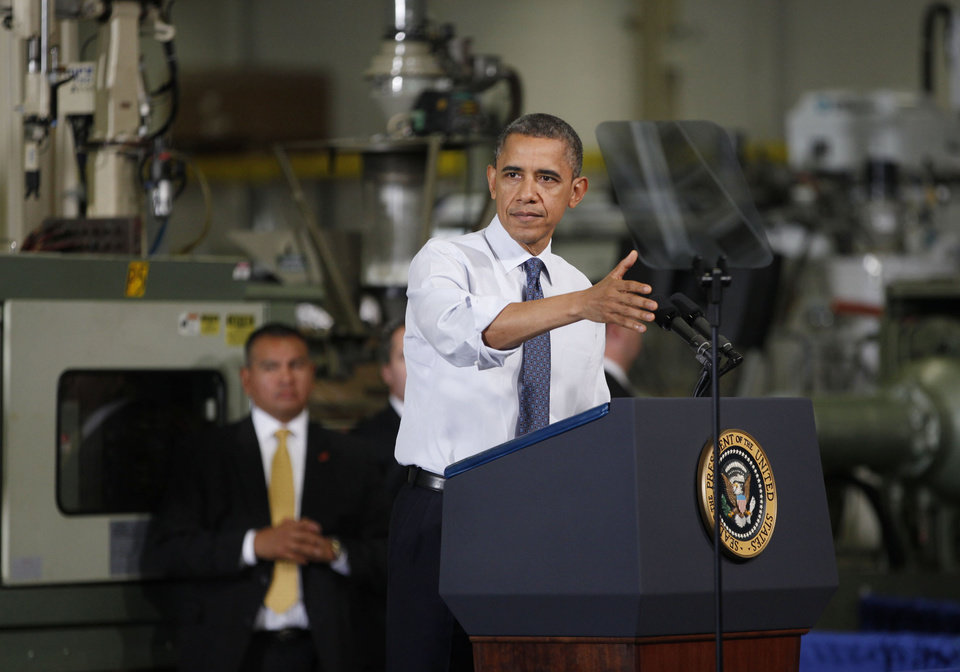 President Barack Obama gestures as he speaks at The Rodon Group manufacturing facility, Friday, Nov. 30, 2012, in Hatfield, Pa. Obama spoke at the toy company about how middle class Americans would see their taxes go up if Congress fails to act to extend the middle class tax cuts. (AP Photo/The Philadelphia Inquirer, Michael S. Wirtz)  PHIX OUT; TV OUT; MAGS OUT; NEWARK OUT (for all of Their spot photos. Outs include 19 or so papers from N.J. and P.A.  MAGS OUT;  NEWARK OUT