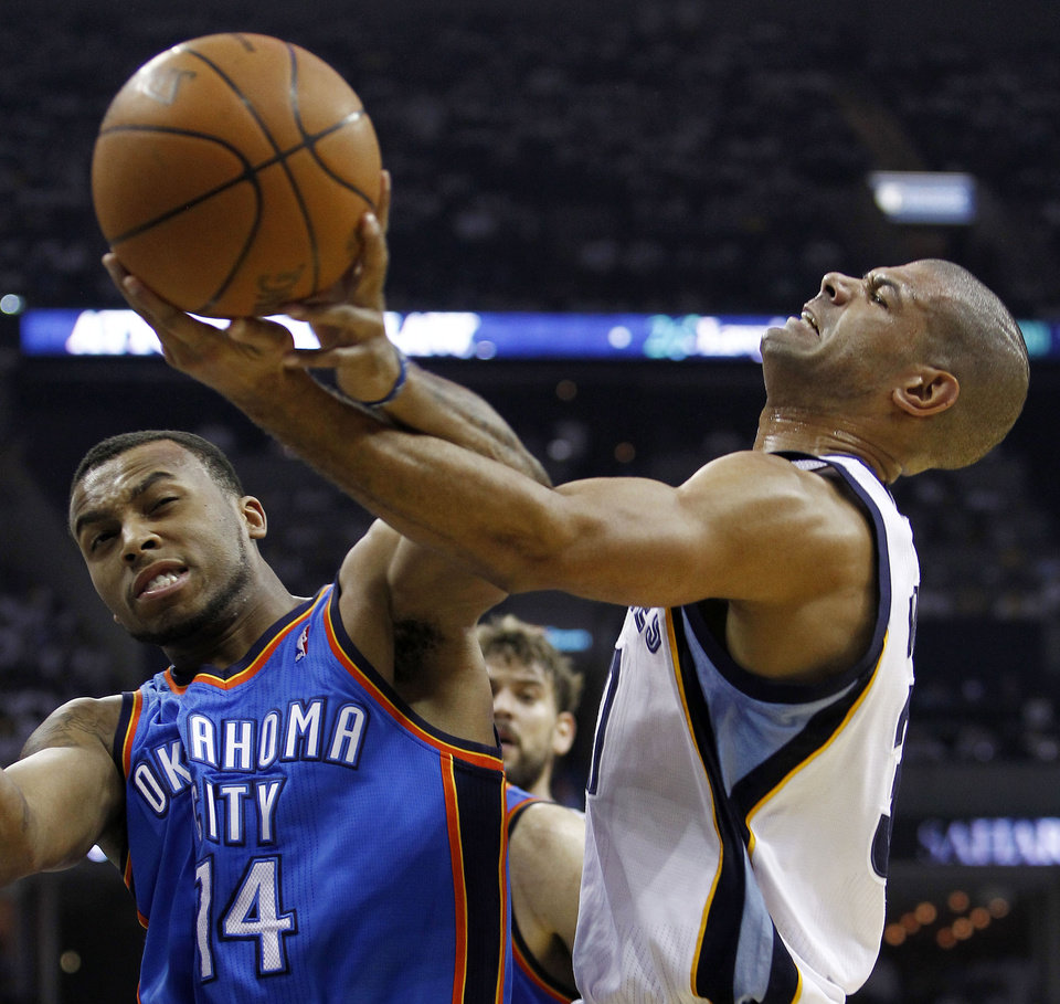 Photo - Oklahoma City Thunder guard Daequan Cook (14) and Memphis Grizzlies forward Shane Battier, right, fight for a rebound during the first half of Game 6 of a second-round NBA basketball playoff series on Friday, May 13, 2011, in Memphis, Tenn. (AP Photo/Wade Payne)