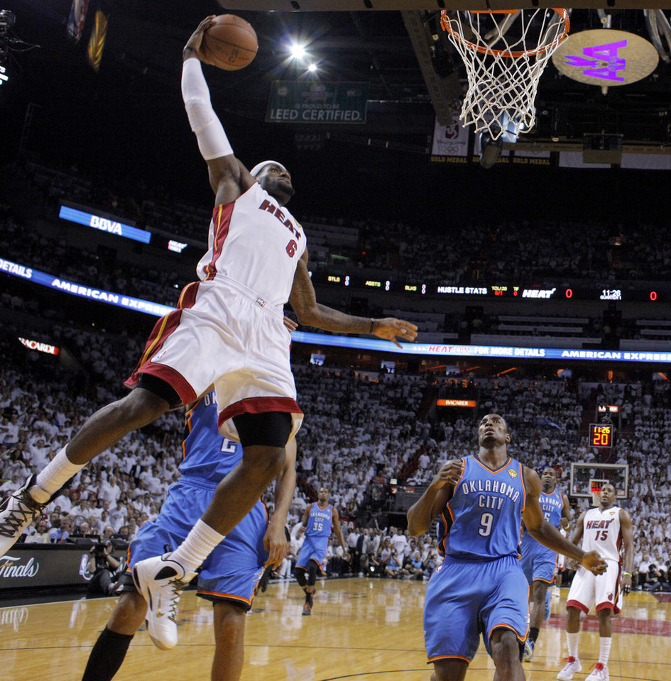 Miami\'s LeBron James (6) goes up for a dunk as Oklahoma City\'s Serge Ibaka (9) watches during Game 5 of the NBA Finals between the Oklahoma City Thunder and the Miami Heat at American Airlines Arena, Thursday, June 21, 2012. Photo by Bryan Terry, The Oklahoman