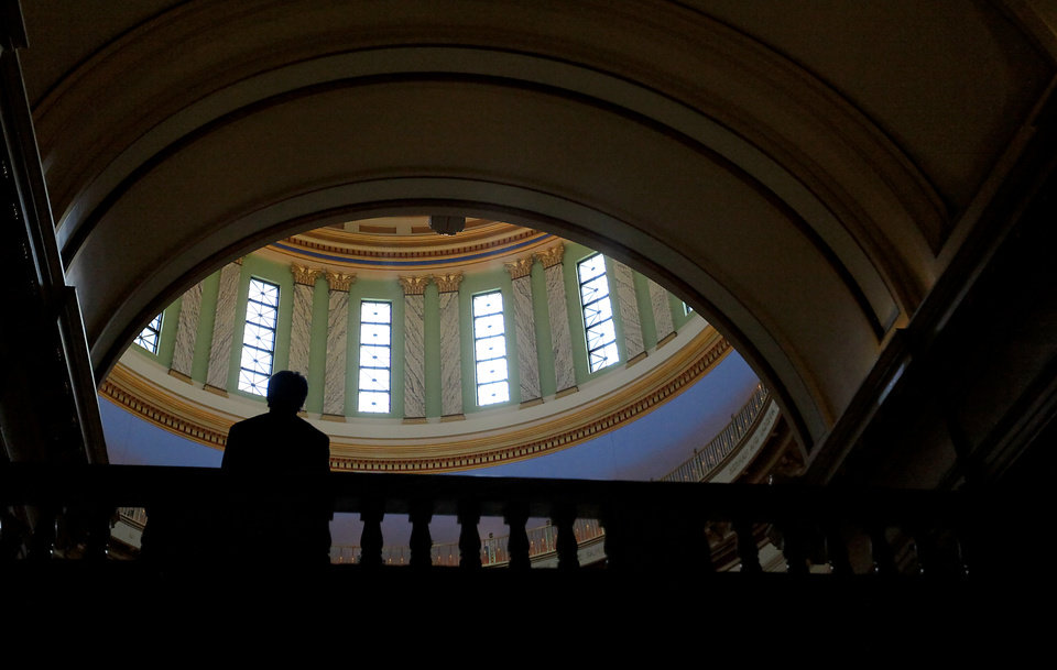 A student is silhouetted while walking the fourth floor as hundreds of high school and college students gather during International Student Awareness Day at the state capitol on Monday, April 2, 2012, in Oklahoma City, Oklahoma.  Photo by Chris Landsberger, The Oklahoman