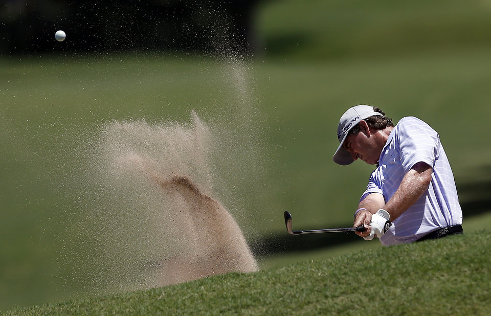 Photo - Gene Sauers hits out of the sand on the 6th hole in the final round of the U.S. Senior Open golf tournament at Oak Tree National in Edmond, Okla., Sunday, July 13, 2014. Photo by Sarah Phipps, The Oklahoman