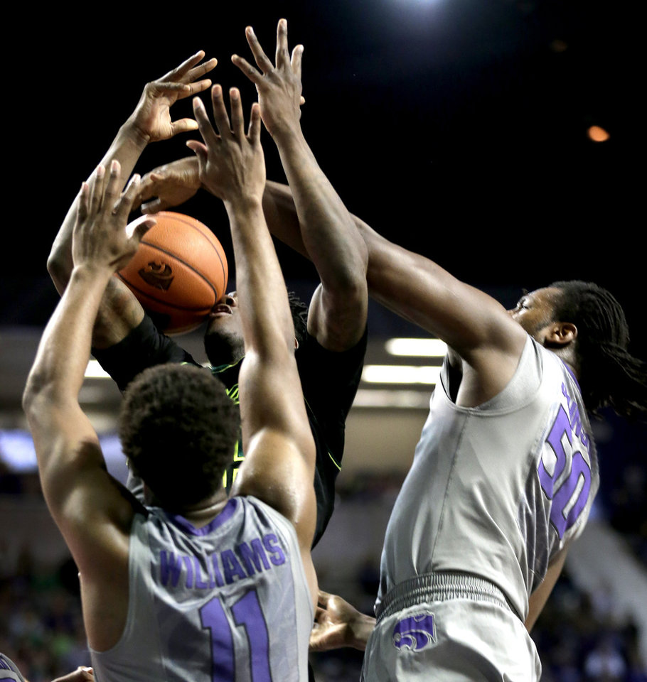 Photo - Baylor's Taurean Prince, back battles Kansas State's Nino Williams (11) and D.J. Johnson (50) for a rebound during the first half of an NCAA college basketball game Saturday, March 8, 2014, in Manhattan, Kan. (AP Photo/Charlie Riedel)