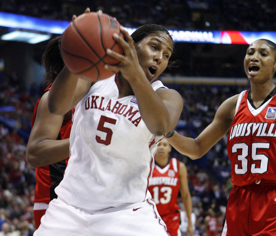 Photo - NCAA TOURNAMENT / OU / ST. LOUIS: Ashley Paris pulls in a rebound in the first half as the University of Oklahoma plays Louisville at the 2009 NCAA women's college basketball tournament Final Four in the Scottrade Center in Saint Louis, Missouri on Sunday, April 5, 2009.   Photo by Steve Sisney, The Oklahoman ORG XMIT: KOD