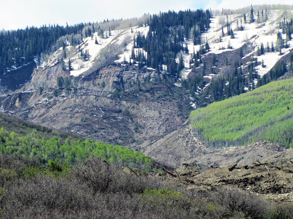 Photo - The results of a three-mile long mudslide appear on Grand Mesa, where the slide started, in a remote part of western Colorado near the small town of Collbran Monday, May 26, 2014. Rescue teams are searching for three men missing after a half-mile stretch of a ridge saturated with rain collapsed.(AP Photo/Mesa County Sheriff's Office)