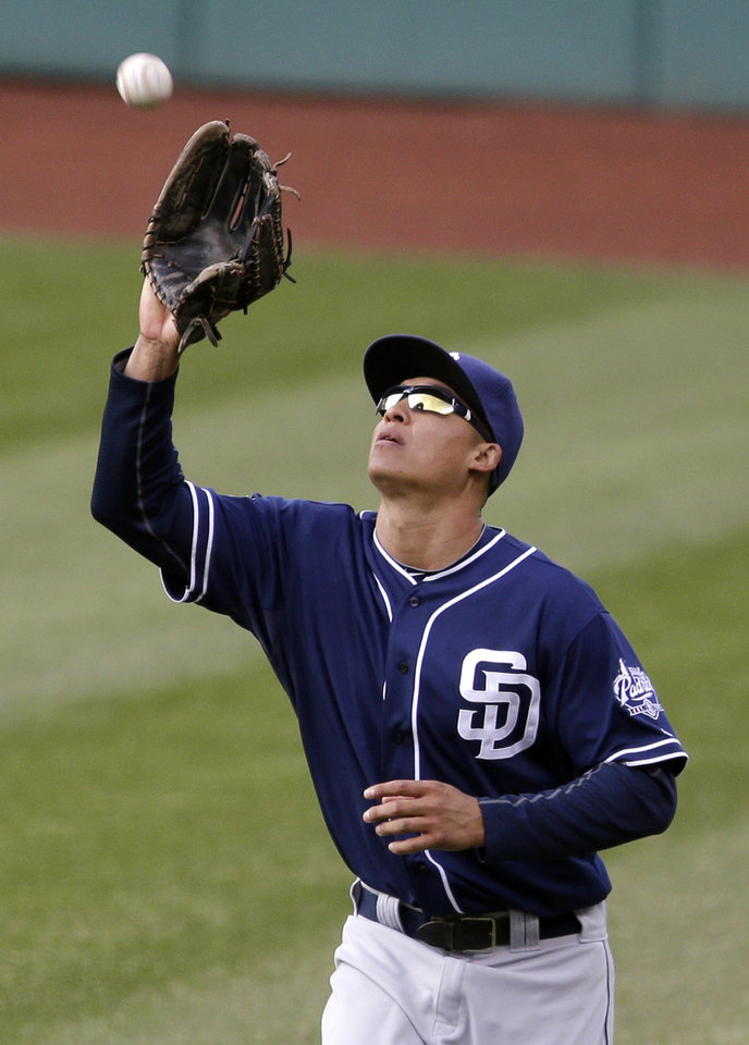 Photo - San Diego Padres center fielder Will Venable catches a fly ball hit by Cleveland Indians' Yan Gomes in the ninth inning of the second game of a baseball doubleheader on Wednesday, April 9, 2014, in Cleveland. The Padres defeated the Indians 2-1. (AP Photo/Tony Dejak)