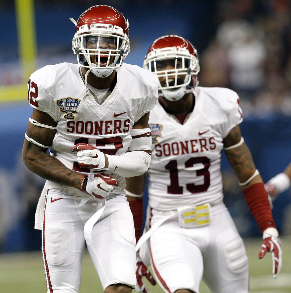Photo - Oklahoma's Derrick Woods (12) and Ahmad Thomas (13) celebrate a play during the NCAA football BCS Sugar Bowl game between the University of Oklahoma Sooners (OU) and the University of Alabama Crimson Tide (UA) at the Superdome in New Orleans, La., Thursday, Jan. 2, 2014. Photo by Sarah Phipps, The Oklahoman