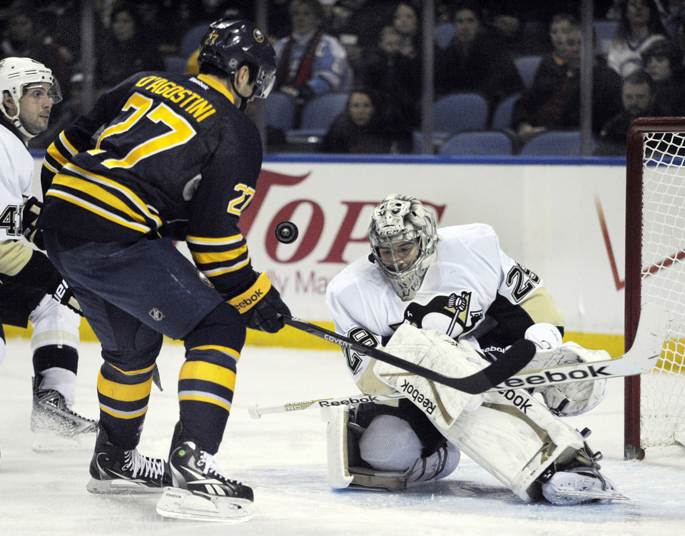 Photo - Buffalo Sabres'  Matt D'Agostini (27) shoots the puck at Pittsburgh Penguins' Marc-Andre Fleury during the first period of an NHL hockey game in Buffalo, N.Y., Wednesday, Feb. 5,  2014. (AP Photo/Gary Wiepert)