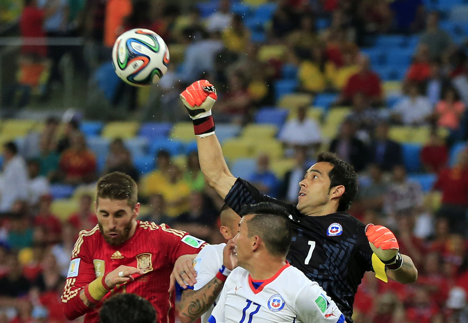 Photo - Chile's goalkeeper Claudio Bravo punches the ball clear during the group B World Cup soccer match between Spain and Chile at the Maracana Stadium in Rio de Janeiro, Brazil, Wednesday, June 18, 2014.  (AP Photo/Bernat Armangue)