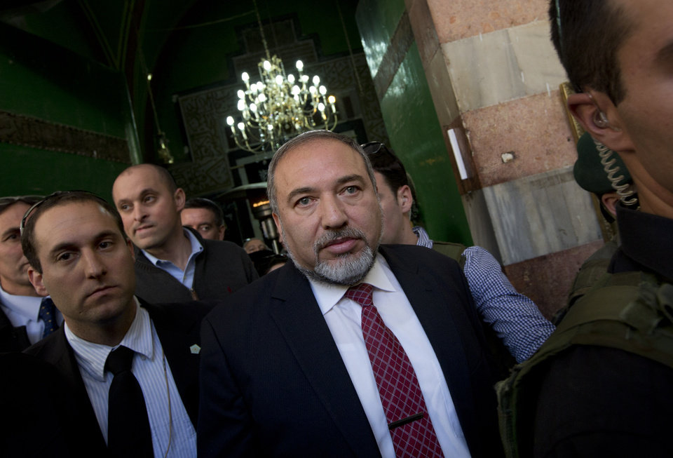 Photo - Israel's former Foreign Minister Avigdor Lieberman, center, visits the site known to Jews as the Tomb of the Patriarchs, and to Muslims as the Ibrahimi Mosque, in the West Bank city of Hebron, Monday, Jan. 14, 2013. Lieberman indicated on Monday that he would quit politics if convicted in his breach of trust and fraud case. (AP Photo/Bernat Armangue)