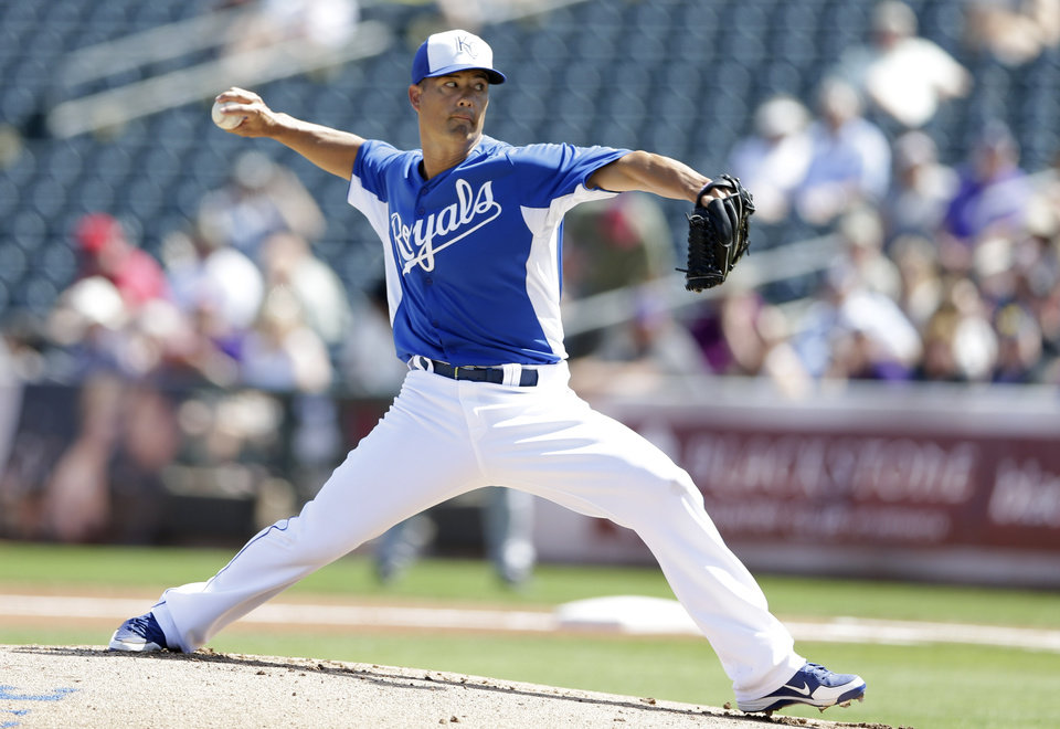 Photo - Kansas City Royals starting pitcher Jeremy Guthrie throw against the Colorado Rockies during the first inning of a spring training baseball game Tuesday, March 19, 2013, in Surprise, Ariz. (AP Photo/Gregory Bull)