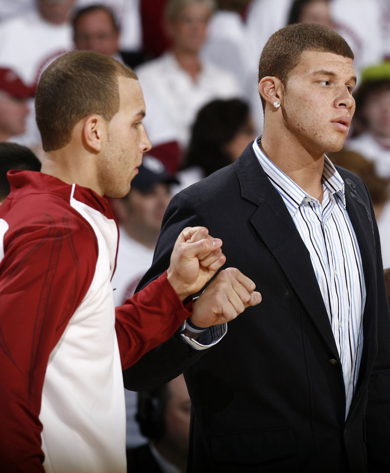 Photo - OU's Taylor Griffin, left, and Blake Griffin bump fists before the men's college basketball game between Kansas and Oklahoma at the Lloyd Noble Center in Norman, Okla., Monday, February 23, 2009. Blake Griffin was injured and did not play. BY NATE BILLINGS, THE OKLAHOMAN