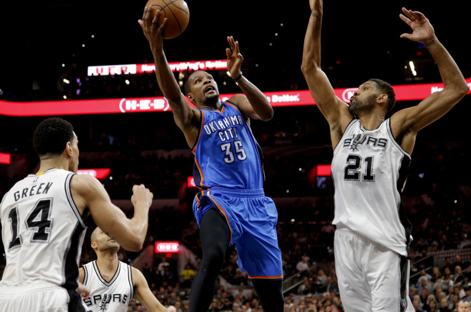 Photo - Oklahoma City's Kevin Durant (35) goes between San Antonio's Tim Duncan (21) and Danny Green (14) during Game 2 of the second-round series between the Oklahoma City Thunder and the San Antonio Spurs in the NBA playoffs at the AT&T Center in San Antonio, Monday, May 2, 2016. Photo by Bryan Terry, The Oklahoman