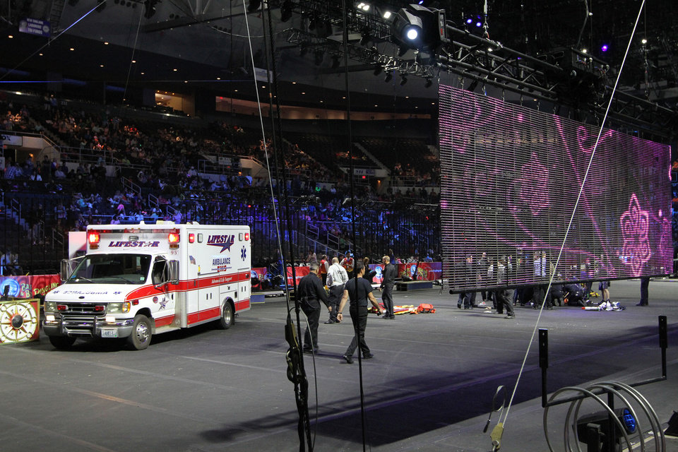 Photo - First responders work at the center ring after a platform collapsed during an aerial hair-hanging stunt at the Ringling Brothers and Barnum and Bailey Circus, Sunday, May 4, 2014, in Providence, R.I. At least nine performers were seriously injured in the fall, including a dancer below, while an unknown number of others suffered minor injuries. (AP Photo/Providence Journal, Bob Breidenbach) MANDATORY CREDIT; ONLINE OUT; RHODE ISLAND MEDIA OUT; NO SALES