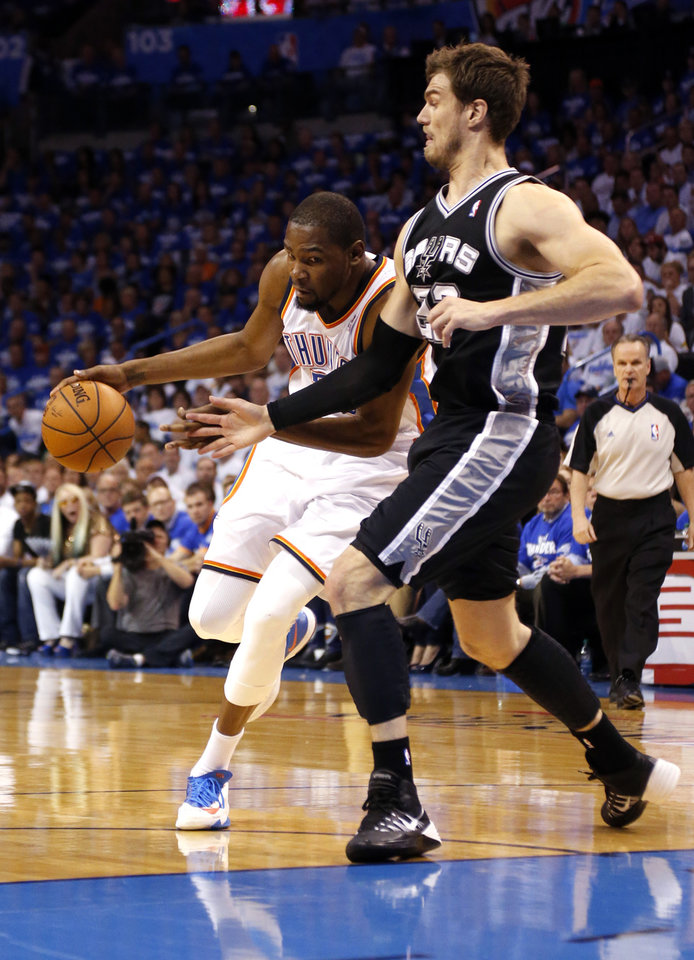 Photo - Oklahoma City's Kevin Durant (35) drives to the basket as San Antonio's Tiago Splitter (22) defends during Game 4 of the Western Conference Finals in the NBA playoffs between the Oklahoma City Thunder and the San Antonio Spurs at Chesapeake Energy Arena in Oklahoma City, Tuesday, May 27, 2014. Photo by Nate Billings, The Oklahoman