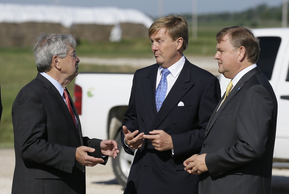 Photo - King Willem-Alexander, center, of the Netherlands, talks with Iowa Gov. Terry Branstad, left, and DSM CEO and Chairman Feike Sijbesma at the opening of one of the nation's first commercial size cellulosic ethanol plants, Wednesday, Sept. 3, 2014, in Emmetsburg, Iowa. Project Liberty is a $250 million plant that will make 25 million gallons of ethanol a year from corn cobs, stalks, leaves and other plant residue. (AP Photo/Charlie Neibergall)