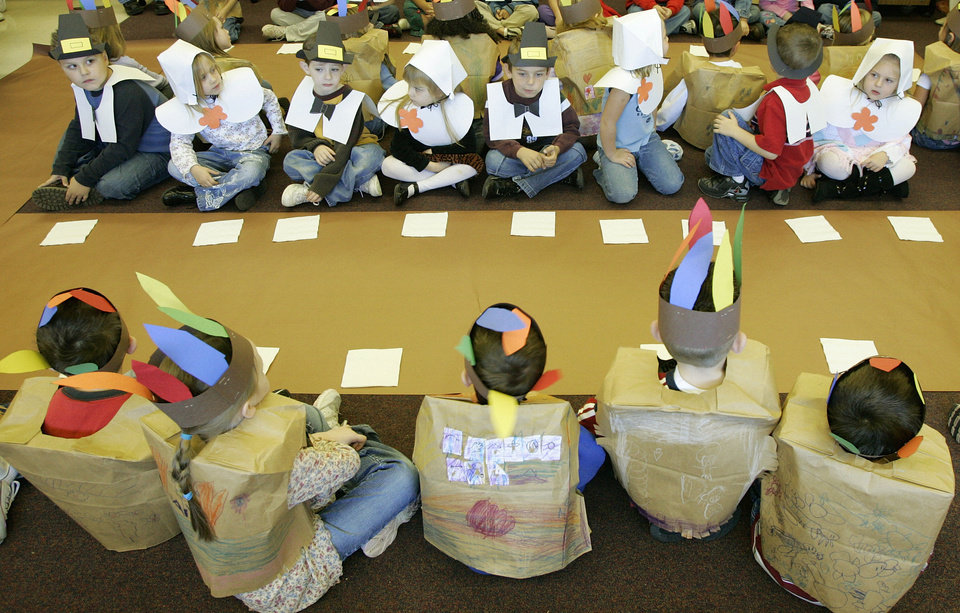 Photo - Kindergartners at Plaza Towers Elementary School in Moore  dressed as pilgrims & American Indians and had a Thanksgiving meal. November 22, 2005.  Steve Gooch /The Oklahoman