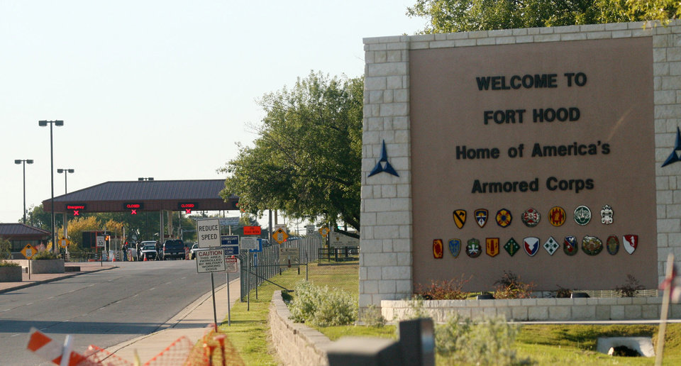 Photo - FILE - In this Thursday, Nov. 5, 2009, file photo, an entrance is shown to Fort Hood Army Base in Fort Hood, Texas. Fort Hood says there's been a shooting at the Texas Army base and that there have been injuries, on Wednesday, April 2, 2014. (AP Photo/Jack Plunkett)