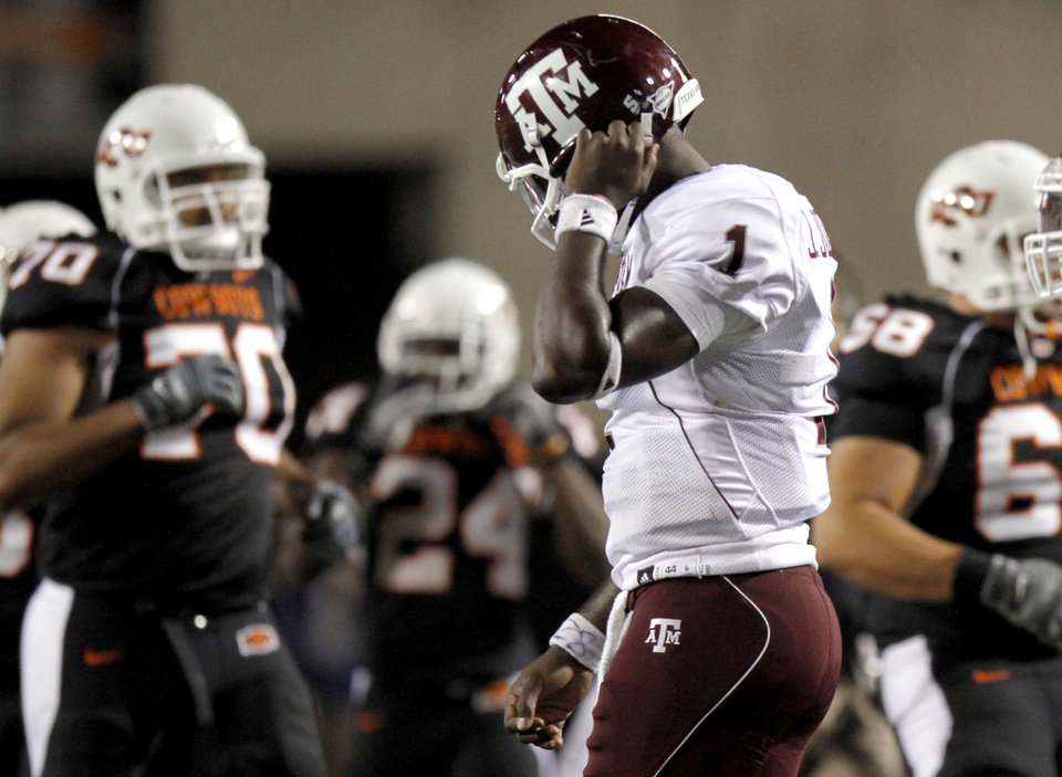 Photo - A&M's Jerrod Johnson reacts after throwing an interception in the final minute of the the fourth quarter during the college football game between Texas A&M University (TAMU) and Oklahoma State University (OSU) at Boone Pickens Stadium in Stillwater, Okla., Thursday, Sept. 30, 2010. Photo by Sarah Phipps, The Oklahoman