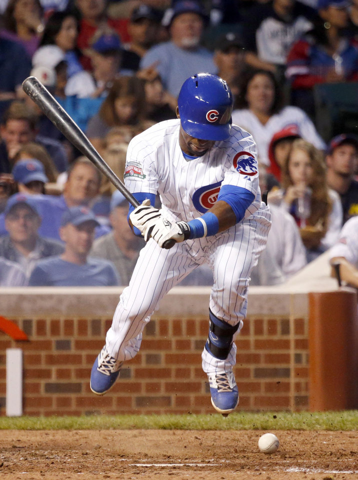 Photo - Chicago Cubs' Arismendy Alcantara is hit by a pitch from Colorado Rockies starting pitcher Jorge De La Rosa during the second inning of a baseball game Tuesday, July 29, 2014, in Chicago. (AP Photo/Charles Rex Arbogast)