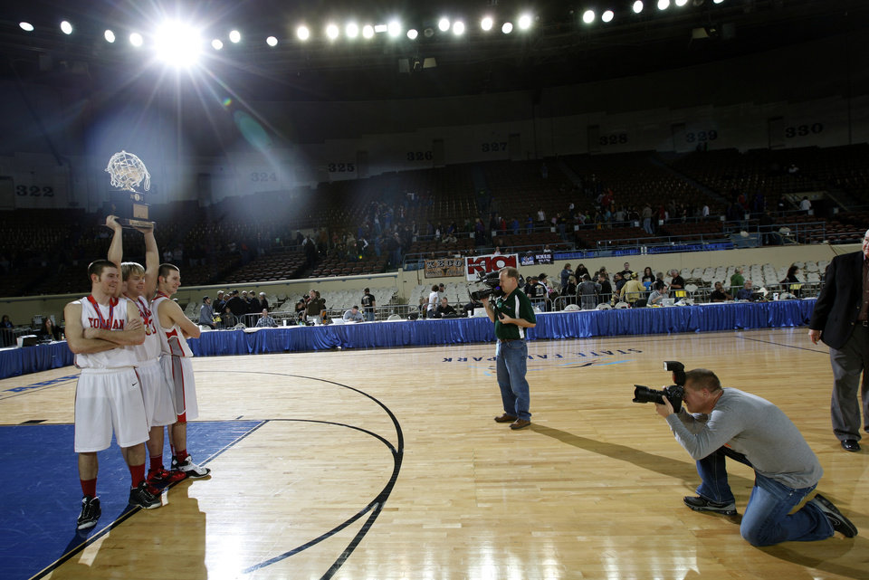 Photo - From left to right, Forgan's Ryan Radcliff, Tanner Jones and Rhett Radcliff celebrates their win over Arnett in the championship game of the boys Class B state basketball tournament at the State Fair Arena in Oklahoma City,  Saturday, March 3, 2012. Photo by Sarah Phipps, The Oklahoman