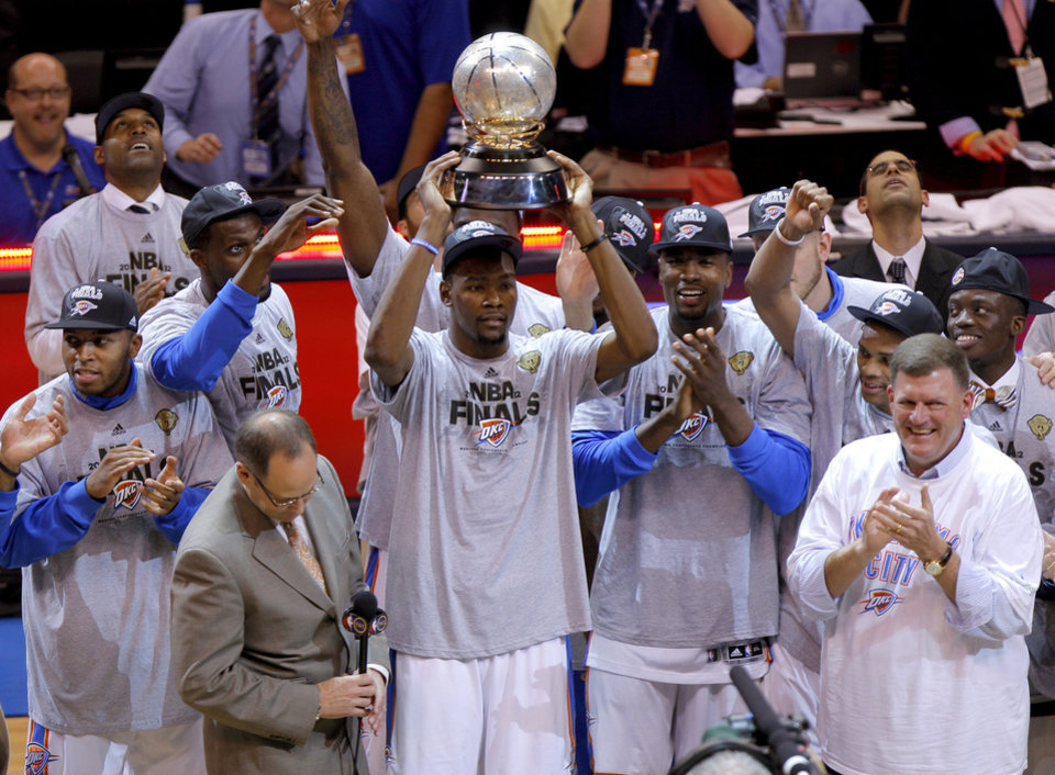 Kevin Durant hold the Western Conference trophy after Game 6 of the Western Conference Finals between the Oklahoma City Thunder and the San Antonio Spurs in the NBA playoffs at the Chesapeake Energy Arena in Oklahoma City, Wednesday, June 6, 2012. Oklahoma City won 107-99. Photo by Bryan Terry, The Oklahoman