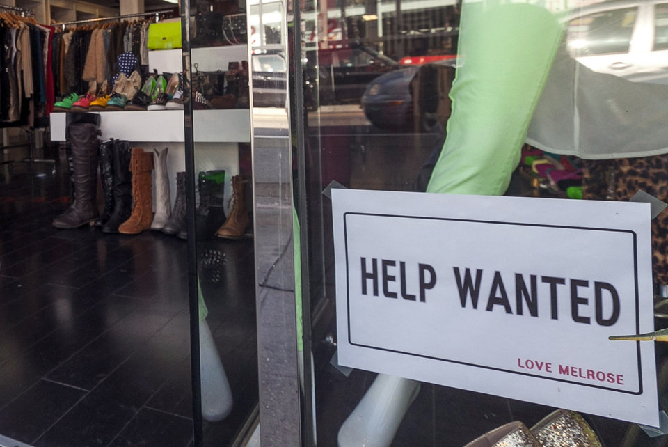 In this Friday, Dec. 7, 2012, photo, a help wanted sign is posted on the front window of a clothing boutique in Los Angeles.The number of Americans seeking unemployment benefits fell sharply for a fourth straight week, a sign that the job market may be improving. The Labor Department said Thursday, Dec. 13, 2012, that weekly applications for unemployment benefits fell 29,000 last week to a seasonally adjusted 343,000, the lowest in two months. It is the second-lowest total this year. (AP Photo/Damian Dovarganes)