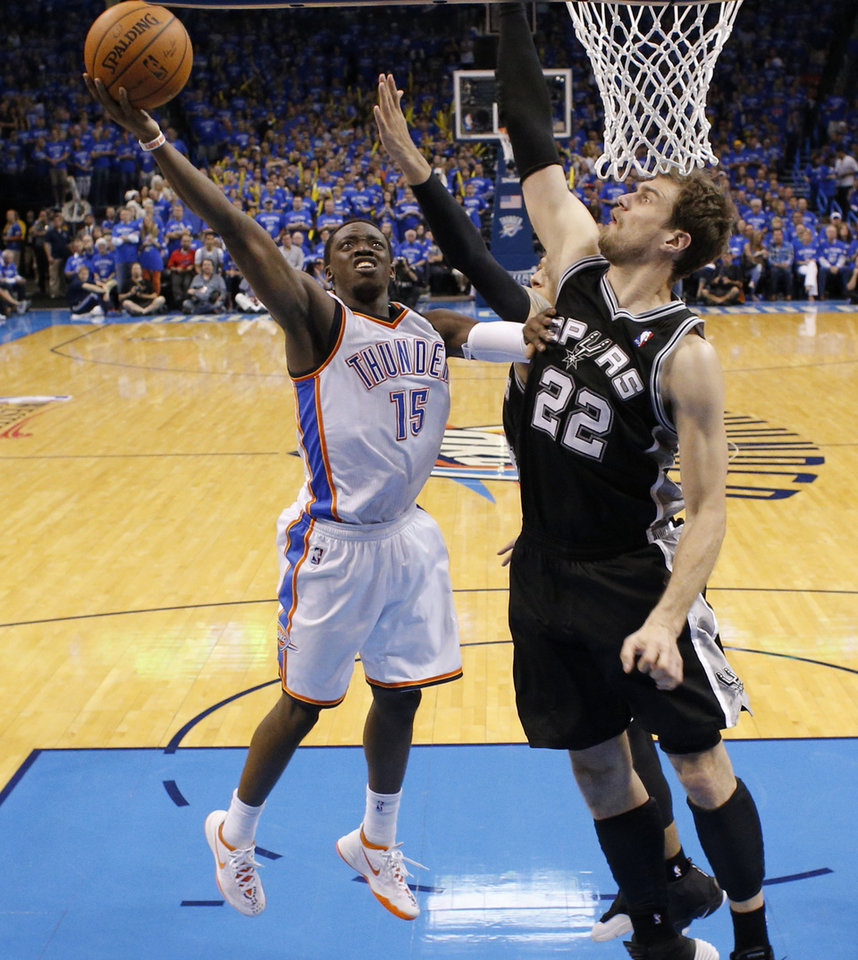 Photo - Reggie Jackson (15) goes to the basket past San Antonio's Tiago Splitter (22) during Game 3 of the Western Conference Finals in the NBA playoffs between the Oklahoma City Thunder and the San Antonio Spurs at Chesapeake Energy Arena in Oklahoma City, Sunday, May 25, 2014. Photo by Bryan Terry, The Oklahoman