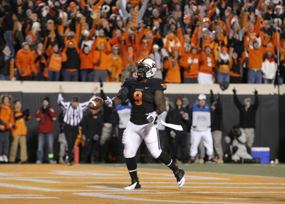 Photo - Oklahoma State's Kye Staley (9) celebrates a touchdown during a college football game between the Oklahoma State University Cowboys (OSU) and the Baylor University Bears (BU) at Boone Pickens Stadium in Stillwater, Okla., Saturday, Nov. 23, 2013. Photo by Sarah Phipps, The Oklahoman