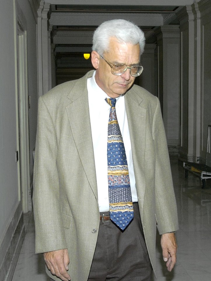 Embattled Court of Criminal Appeals Judge Steve Lile resigned Monday, Feb. 28, 2005, ending an investigation into his activities by the Oklahoma attorney general. Lile is shown as he leaves his office in the Court of Criminal Appeals at the State Capitol, in Oklahoma City.   Staff Photo by Jim Beckel.